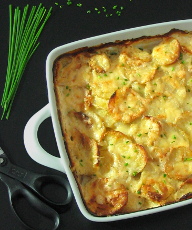 Garlic Cheesy Potatoes - baked in a lightened-up creamy sauce, these are the ultimate comfort food! | sliceofkitchenlife.com