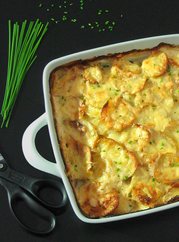 Garlic Cheesy Potatoes - baked in a lightened-up creamy sauce, these are the ultimate comfort food!   sliceofkitchenlife.com
