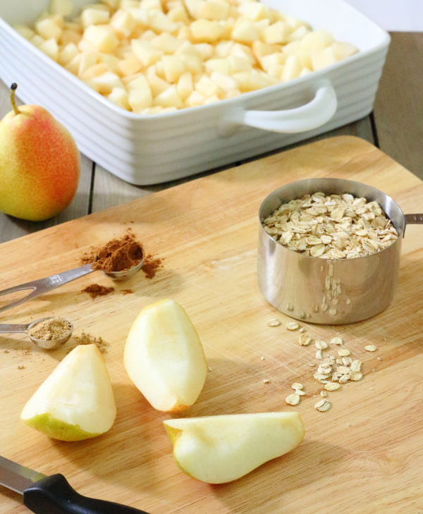 Spiced Pear & Chocolate Crisp Recipe - Pears, chocolate and spices are combined in this tasty fruit crisp, made with whole-grains, coconut oil and maple syrup.