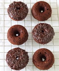 Baked Chocolate Doughnuts Recipe - Soft and fluffy and thickly frosted with a rich mocha ganache, they make getting out of bed worthwhile! | sliceofkitchenlife.com