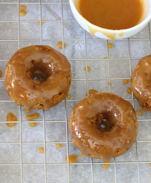 Baked Pumpkin Doughnuts with Salted Maple Caramel Recipe - These soft and fluffy baked pumpkin doughnuts are drizzled with a salted maple caramel for a sticky-sweet breakfast treat! | sliceofkitchenlife.com