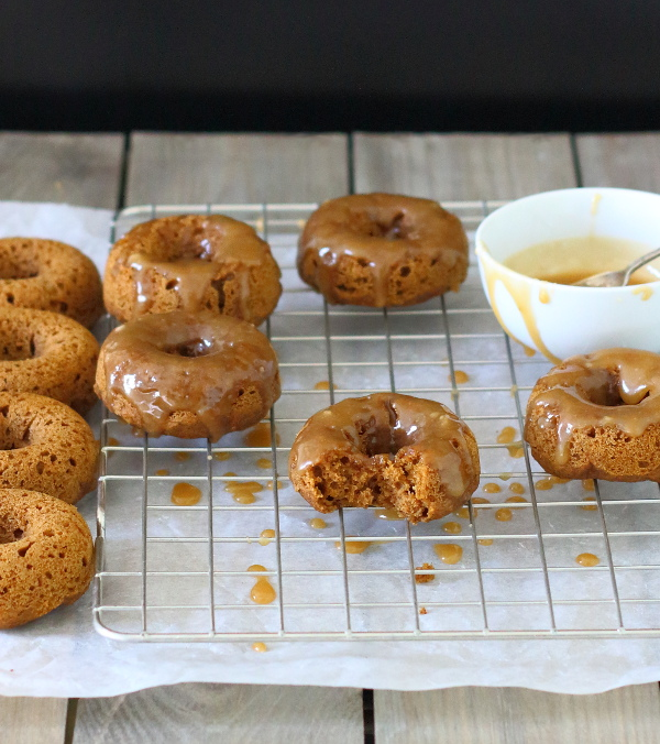 Baked Pumpkin Doughnuts with Salted Maple Caramel Recipe - These soft and fluffy baked pumpkin doughnuts are drizzled with a salted maple caramel for a sticky-sweet breakfast treat!