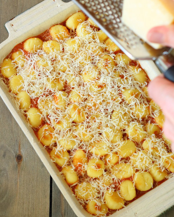 Sausage, Pepper and Gnocchi Casserole (One-Pot) - Sausages and peppers in a rich, creamy tomato and basil sauce, topped with crispy, cheesy gnocchi.