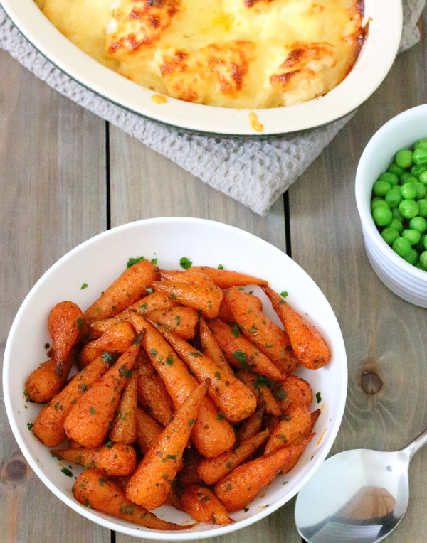 Smoky-Sweet Maple Roasted Carrots Recipe - Transform boring everyday veg into something special - these easy, tasty maple roasted carrots only take a few minutes to prepare!